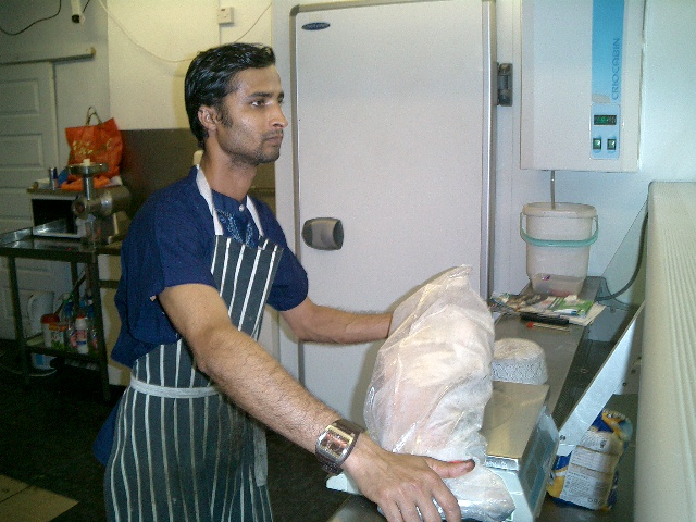 butcher cutting fish